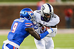 Southern Methodist Mustangs defensive back Horace Richardson (9) and TCU Horned Frogs running back Kyle Hicks (21) in action during the game between the TCU Horned Frogs and the SMU Mustangs at the Gerald J. Ford Stadium in Dallas, Texas.