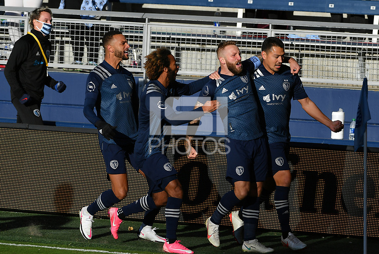 KANSAS CITY, KS - NOVEMBER 22: Khiry Shelton #11, Gianluca Busio #27, Johnny Russell #7 and Roger Espinoza #15 of Sporting KC celebrate Roger's goal at the beginning of the game before a game between San Jose Earthquakes and Sporting Kansas City at Children's Mercy Park on November 22, 2020 in Kansas City, Kansas.