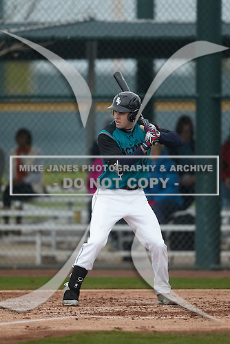 Alex Binelas (12) of Oak Creek HS High School in Oak Creek, Wisconsin during the Under Armour All-American Pre-Season Tournament presented by Baseball Factory on January 15, 2017 at Sloan Park in Mesa, Arizona.  (Kevin C. Cox/Mike Janes Photography)