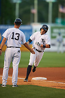 Tampa Yankees manager Pat Osborn (13) congratulates Michael O'Neill after hitting a home run during a game against the Dunedin Blue Jays on April 19, 2016 at George M. Steinbrenner Field in Tampa, Florida.  Tampa defeated Dunedin 12-7.  (Mike Janes/Four Seam Images)