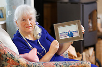 Pictured: Lynne Lewis holding a picture of her late husband, at her house is Pentwyn near Pontypool, Wales, UK. Sunday 09 December 2018<br /> Re: Lynne Lewis, 66, from Pentwyn, south Wales, whose late husband Thomas John Lewis worked for BT for 42 years and BT keep delaying his pension pay out after his death in early November 2018.