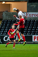 Monday 20 January 2014<br /> Pictured:Rory Donnelly and Luke Coulson  jump for the ball <br /> Re: Swansea City U21 v Cardiff City U21 at the Liberty Stadium, Swansea Wales