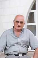 Veselko Sivric, owner and wine maker, outside his winery. Podrum Vinoteka Sivric winery, Citluk, near Mostar. Federation Bosne i Hercegovine. Bosnia Herzegovina, Europe.