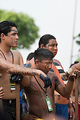 Indigenous Brazilian competitors prepare for the canoeing event at the International Indigenous Games, in the city of Palmas, Tocantins State, Brazil. Photo © Sue Cunningham, pictures@scphotographic.com 30th October 2015