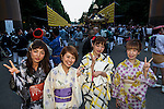 Visitors dressed in traditional Japanese clothing pose for a picture during the annual ''Mitama Festival'' at Yasukuni Shrine on July, 13, 2015, Tokyo, Japan. Over 30,000 lanterns line the entrance to the shrine to help spirits find their way during the annual celebration for the spirits of ancestors. The festival is held from July 13th to 16th. (Photo by Rodrigo Reyes Marin/AFLO)