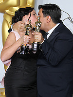 HOLLYWOOD, LOS ANGELES, CA, USA - MARCH 02: Kristen Anderson-Lopez, Robert Lopez at the 86th Annual Academy Awards - Press Room held at Dolby Theatre on March 2, 2014 in Hollywood, Los Angeles, California, United States. (Photo by Xavier Collin/Celebrity Monitor)