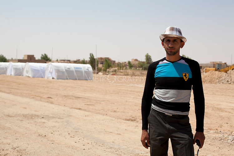 QAIM, IRAQ: Ali, a coordinator at the Qaim refugee camp for refugees fleeing the violence in Syria..Over 4,450 Syrian refugees have fled the violence in Syria and are living in the Qaim refugee camp in Iraq...Photo by Ali Arkady/Metrography