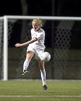 """Boston College midfielder Julia Bouchelle (12) clears the ball. Boston College defeated West Virginia, 4-0, in NCAA tournament """"Sweet 16"""" match at Newton Soccer Field, Newton, MA."""