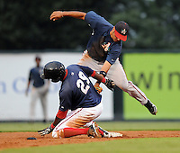 Second baseman Angelys Nina (2) of the Asheville Tourists applies the tag as Vladimir Frias (29) of the Greenville Drive is picked off from a throw by pitcher Chris Balcom-Miller in the third inning of a game on Aug. 29, 2010, at Fluor Field at the West End in Greenville, S.C. Photo by: Tom Priddy/Four Seam Images