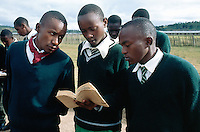 Kenya. Rift Valley Province. Nyahururu. Munyaka secondary school. Students stay on line in the early morning for the rising of the kenyan flag. The boys  wearing the same green uniform. © 2004 Didier Ruef