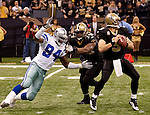 December 2009: Dallas Cowboys linebacker DeMarcus Ware (94) pressures New Orleans Saints quarterback Drew Brees (9) during an NFL football game at the Louisiana Superdome in New Orleans.  The Cowboys defeated the Saints 24-17.