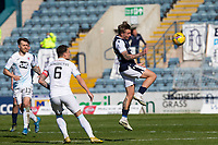 24th April 2021; Dens Park, Dundee, Scotland; Scottish Championship Football, Dundee FC versus Raith Rovers; Jason Cummings of Dundee heads the ball as Kyle Benedictus of Raith Rovers watches