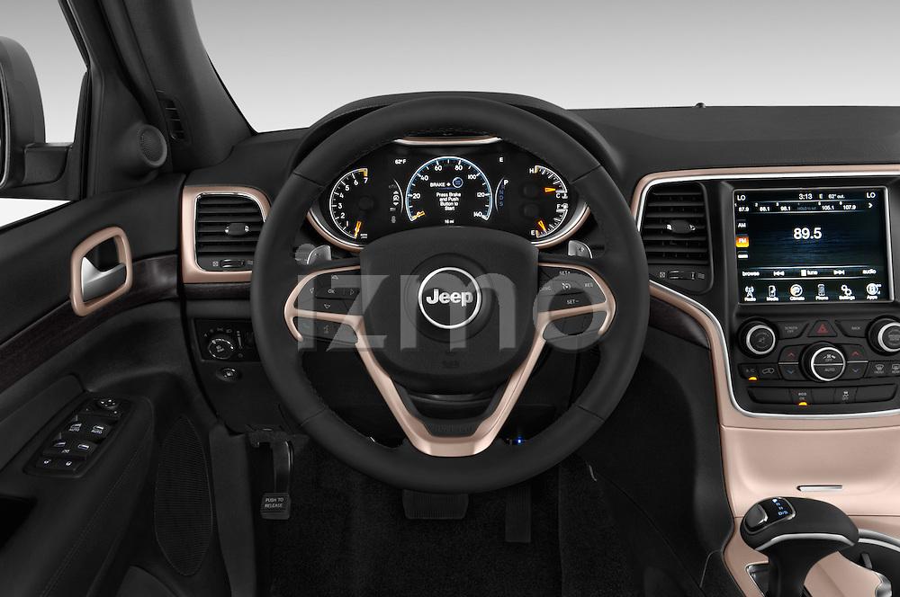 Car pictures of steering wheel view of a 2014 JEEP Grand Cherokee Laredo 5 Door SUV Steering Wheel