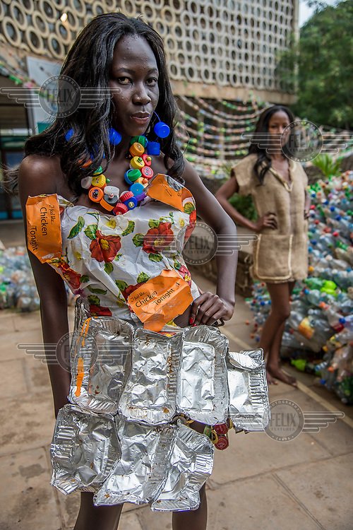 A model at the Trash on Fashion Show, part of the Bayimba cultural festival at the Kampala National Theatre, wearing clothes and jewellery made from waste plastic and foil food trays created by Gisa Jr Gong Brian and the Afrika Arts Kollective, which specialises in waste recovery and recycling. Their goal is to make the public aware of the possibilities of economy and ecology which conceal everyday life and its waste.