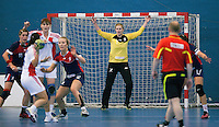 22 OCT 2011 - LONDON, GBR - Britain's goalkeeper Sarah Hargreaves (in yellow and black) prepares to try and save a shot during Britain's Women's 2012 European Handball Championship qualification match against Russia at the National Sports Centre at Crystal Palace (PHOTO (C) NIGEL FARROW)