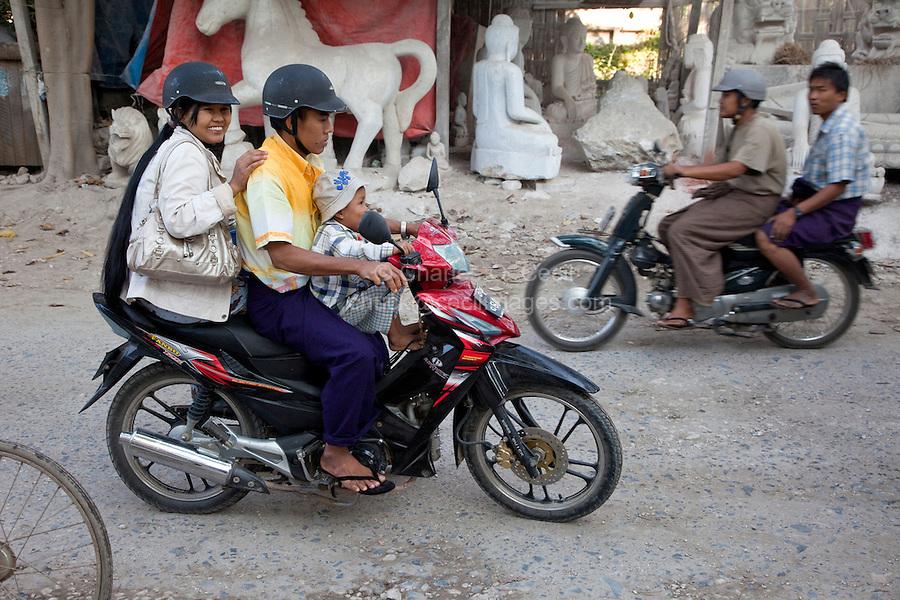 Myanmar, Burma, Mandalay.  Motorcycle Safety.  Child without Helmet.