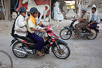 Myanmar, Burma, Mandalay.  Motorcycle Safety.  Child without Helmet.