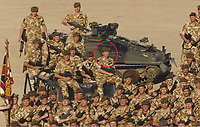 BNPS.co.uk (01202 558833)<br /> Pic: DNW/BNPS<br /> <br /> Pictured: Corporal Tony Currie (circled) led his team forward against 20 enemy gunmen during a prolonged firefight.<br /> <br /> A hero Iraq War veteran who led a full-frontal assault against 20 enemy gunmen has sold his bravery medals for £15,000.<br /> <br /> Corporal Tony Currie was part of a small force which came under heavy machine gun fire near the Al Uzayr security base in the Maysan Province in 2003. They were shot at from five different positions as they advanced through narrow streets.<br /> <br /> During the assault, an Iraqi gunman appeared suddenly in front of the British to stall the attack.