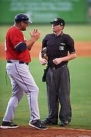 Fort Myers Miracle manager Jeff Smith (40) questions a call from umpire Jordan Johnson during a game against the Bradenton Marauders on August 3, 2016 at McKechnie Field in Bradenton, Florida.  Bradenton defeated Fort Myers 9-5.  (Mike Janes/Four Seam Images)