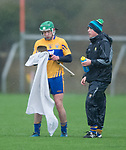 David Conroy of Clare dries off his hurley during the Jack Lynch Memorial game against Wexford at Tulla. Photograph by John Kelly.