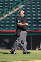 Home plate umpire Randy Collins between innings of the South Atlantic League game between the Savannah Sand Gnats and the Hickory Crawdads at L.P. Frans Stadium on June 14, 2015 in Hickory, North Carolina.  The Crawdads defeated the Sand Gnats 8-1.  (Brian Westerholt/Four Seam Images)