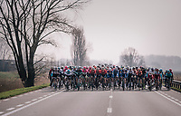 The peloton taking it easy after the breakaway group is allowed to go free<br /> <br /> 81st Gent-Wevelgem in Flanders Fields (1.UWT)<br /> Deinze > Wevelgem (251km)