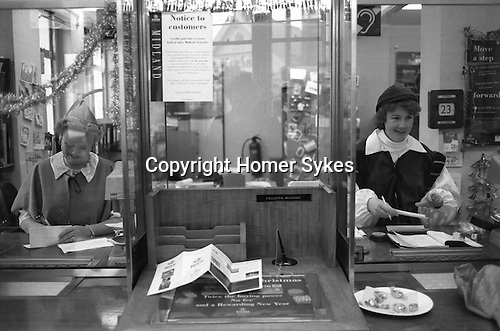 The Midland Bank, December 23rd 1994. Southfields Branch, London SW18.  Each year the manager of this branch ( my branch ) threw a Christmas Party for the staff and customers. The Fancy Dress was themed and in 1994 the theme was Robin Hood.<br /> <br /> Sweets on the counter.