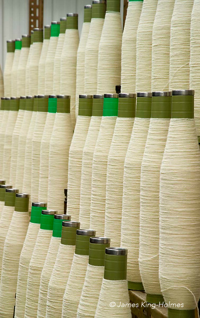 Reels of newly spun organic sheep's wool in a textile mill specialising in the processing of organic wool. Photographed at the Natural Fibre Company Ltd, Launceston, UK.