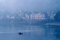 Men fishing from small boat on the Loire River, Samur, France