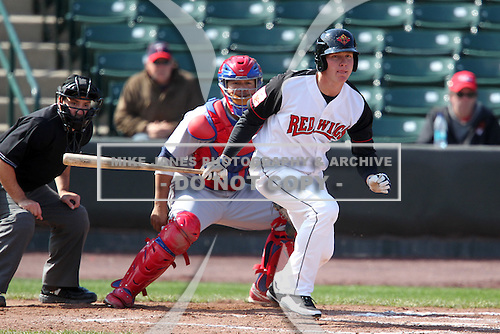 Rochester Red Wings outfielder Dustin Martin #16 at bat with catcher Dane Sardinha #22 and umpire David Rackley during the second game of a double header against the Lehigh Valley Ironpigs at Frontier Field on April 14, 2011 in Rochester, New York.  Lehigh Valley defeated Rochester 5-3 in extra innings.  Photo By Mike Janes/Four Seam Images