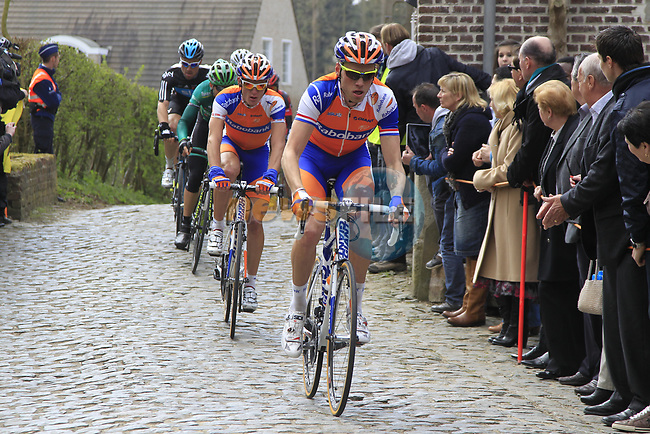 The peloton led out by Lars Boom (NED) Rabobank climb Molenberg during the 96th edition of The Tour of Flanders 2012, running 256.9km from Bruges to Oudenaarde, Belgium. 1st April 2012. <br /> (Photo by Eoin Clarke/NEWSFILE).