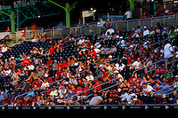 Cardinals fans bask in the late evening light during a game between the Northwest Arkansas Naturals and the Springfield Cardinals at Hammons Field on July 30, 2011 in Springfield, Missouri. Springfield defeated Northwest Arkansas 11-5. (David Welker / Four Seam Images).