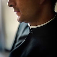 A priest wears a clerical collar. Neatness of dress is one of the most important hallmarks of the Legionaries of Christ. The Legion of Christ is a conservative Roman Catholic congregation whose members take vows of chastity, obedience and poverty.