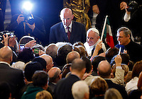 Papa Francesco, affiancato dal presidente di Libera don Luigi Ciotti, a destra, saluta i fedeli al termine della veglia di preghiera per le vittime innocenti della mafia nella parrocchia di San Gregorio VII a Roma, 21 marzo 2014.<br /> Pope Francis, flanked by Libera anti-mafia association's president don Luigi Ciotti, right, greets faithful at the end of a vigil prayer for innocent victims of mafia, at the parish church of San Gregorio VII in Rome, 21 March 2014.<br /> UPDATE IMAGES PRESS/Riccardo De Luca<br /> <br /> STRICTLY ONLY FOR EDITORIAL USE