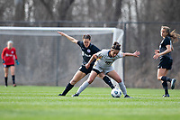 LOUISVILLE, KY - MARCH 13: Chinyelu Asher #43 of Racing Louisville FC and Maya Ladhani #16 of West Virginia University battle for the ball during a game between West Virginia University and Racing Louisville FC at Thurman Hutchins Park on March 13, 2021 in Louisville, Kentucky.