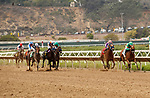 DEL MAR, CA  AUGUST 21: First race and #2 Ain't Easy, ridden by Joel Rosario and trained by Phil D'Amato leads into the stretch on August 21, 2021 at Del Mar Thoroughbred Club in Del Mar, CA.  (Photo by Casey Phillips/Eclipse Sportswire/CSM)