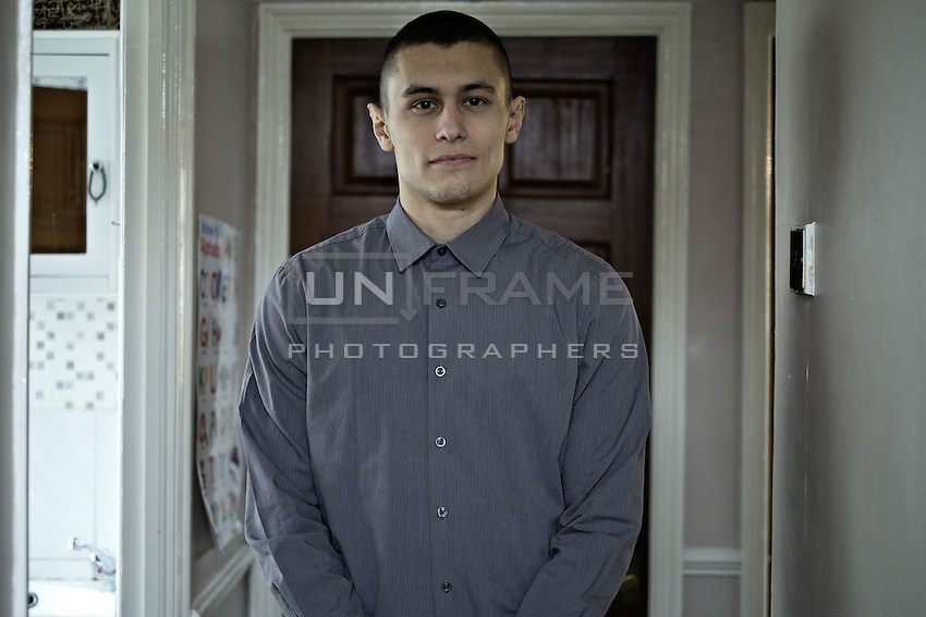 Przemek Kierpacz, professional Thai boxer and Roma Support Group advocate, poses in his home. London, UK, 9th March 2015.