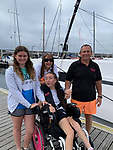 Pictured:  Natasha Lambert (centre) with her mum Amanda, Dad Gary and sister Rachel.<br /> <br /> A young woman with cerebral palsy has sailed 3,000 miles across the Atlantic ocean in just 18 days - using only her mouth and tongue to control the boat.<br /> <br /> Natasha Lambert, 23, used the 'sip and puff' system engineered by her electrician father to sail from Gran Canaria on the Western coast of Africa to St Lucia in the Caribbean.<br /> <br /> The trip, which hoped to raise £30,000 for three charities, took 18 days, 24 hours, 29 minutes and eight seconds to complete.  SEE OUR COPY FOR DETAILS.<br /> <br /> © Solent News & Photo Agency<br /> UK +44 (0) 2380 458800