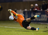 Scott Goodwin (1) of North Carolina makes a save on a penalty kick  during the game at the Maryland SoccerPlex in Germantown, MD. North Carolina defeated Virginia on penalty kicks after playing to a 0-0 tie in regulation time.  With the win the Tarheels advanced to the finals of the ACC men's soccer tournament.
