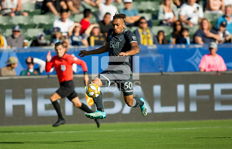 CARSON, CA - SEPTEMBER 29: Theo Bair #50 of the Vancouver Whitecaps moves with the ball during a game between Vancouver Whitecaps and Los Angeles Galaxy at Dignity Health Sports Park on September 29, 2019 in Carson, California.