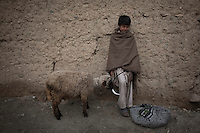 A boy rests after working in the fields.