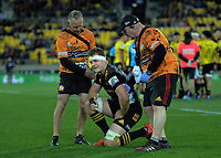Injured Chiefs captain Sam Cane is taken off during the Super Rugby Aotearoa match between the Hurricanes and Chiefs at Sky Stadium in Wellington, New Zealand on Saturday, 8 August 2020. Photo: Dave Lintott / lintottphoto.co.nz