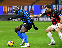 Football Soccer: Tim Cup Quarter Finals InternazionaleMIlan vs Milan, Giuseppe Meazza Stadium (San Siro) Milan, on January 26, 2021.<br /> Inter's Romelu Lukaku (l) in action with Milan's captain Alessio Romagnoli (r) during the Italian Tim Cup football match between Inter  and Milan at the Giuseppe Meazza stadium in Milan, January 26, 2021.<br /> UPDATE IMAGES PRESS/Isabella Bonotto