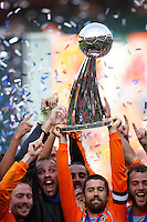 Houston Dynamo defender (24) Wade Barrett hoists the Alan I Rothenberg trophy above his head as teammates celebrate. The Houston Dynamo defeated the New England Revolution 2-1 in the finals of the MLS Cup at RFK Memorial Stadium in Washington, D. C., on November 18, 2007.