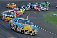 Nov 13, 2005; Phoenix, Ariz, USA;  Nascar Nextel Cup driver Jeff Green driver of the #43 Cheerios Dodge leads a pack of cars during the Checker Auto Parts 500 at Phoenix International Raceway. Mandatory Credit: Photo By Mark J. Rebilas