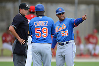 GCL Mets manager Jose Carreno (55) argues a call with umpire D.J. Jones as coach Ender Chavez (59) listens in during the first game of a double header against the GCL Cardinals on July 17, 2013 at Roger Dean Complex in Jupiter, Florida.  GCL Cardinals defeated the GCL Mets 6-5 in twelve innings.  (Mike Janes/Four Seam Images)