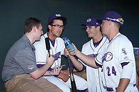 Blake Rutherford (center) is interviewed by Winston-Salem Dash color commentator Jake Eisenberg with an assist from pitcher Dylan Cease (29) and first baseman Gavin Sheets (24) prior to the game against the Lynchburg Hillcats at BB&T Ballpark on May 3, 2018 in Winston-Salem, North Carolina. The Dash defeated the Hillcats 5-3. (Brian Westerholt/Four Seam Images)