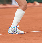 Samantha Stosur, (AUS) with a heavily bandaged calf/shin, battles against Dominika Cibulkova (SVK) at  Roland Garros being played at Stade Roland Garros in Paris, France on May 30, 2014