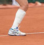 Samantha Stosur, (AUS) with a heavily bandaged calf/shin, battles against Dominika Cibulkova (SVK)
