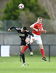 Niall Hanley of Janesboro in action against David Mc Carthy of Newmarket Celtic during their Munster Junior Cup semi-final at Limerick. Photograph by John Kelly.